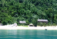 Cham island- full of white sand, trees and clouds